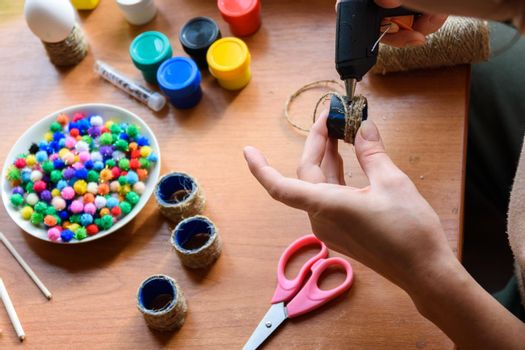 The girl's hands make crafts with a rut pistol