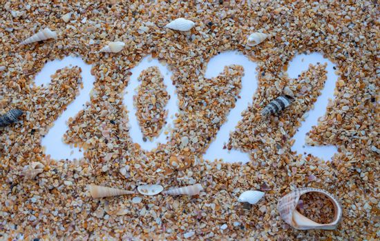 The number 2022 is drawn on the sand of shells.New Year's Calendar.