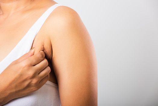 woman pulling her skin underarm she problem armpit fat underarm wrinkled skin