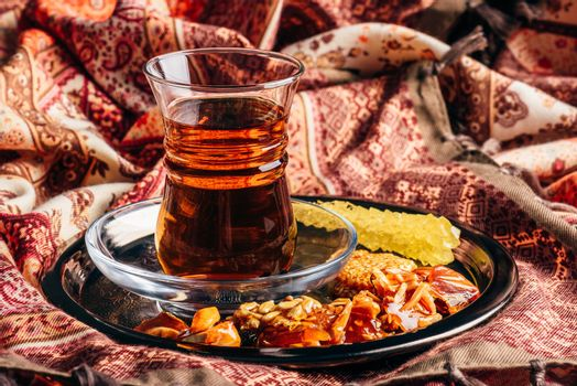 Tea in armudu with oriental delights and crystal sugar