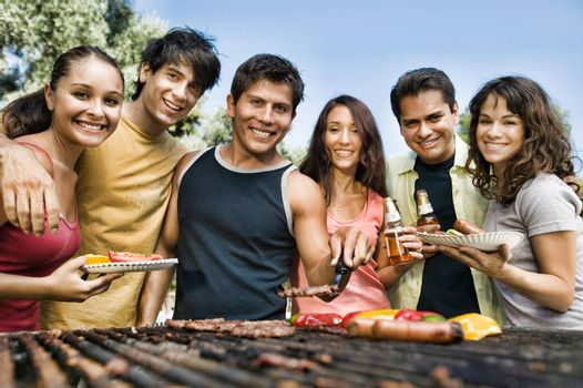 Caucasian Friends at a Picnic having barbeque