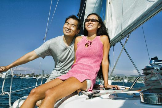 Portrait of chinese couple on yacht