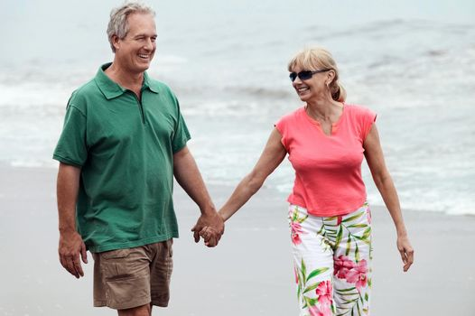 Portrait of Couple Walking Hand in Hand on Beach