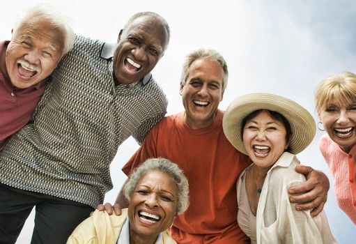 Multi ethnic Group of Friends Laughing on the beach