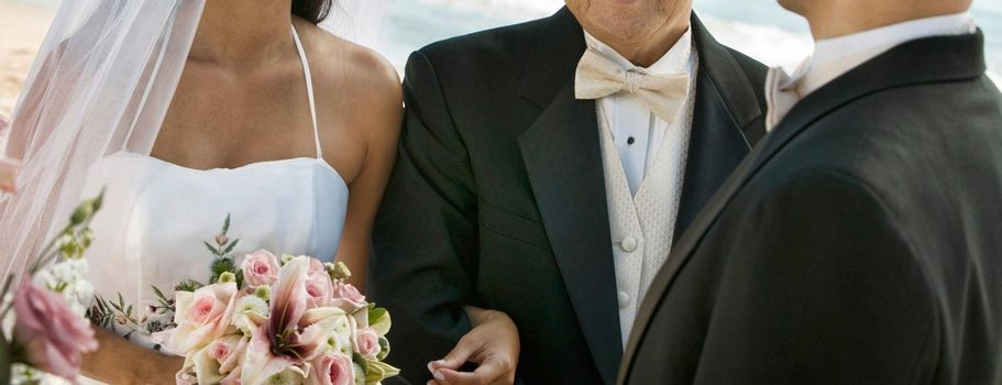 Bride and Father Arm in Arm With Groom