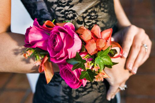 Close up photo of woman in prom with corsage