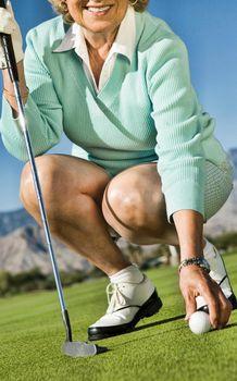 Woman Picking up Golf Ball