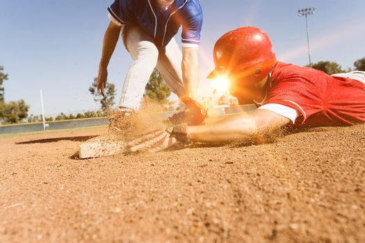 Photo of Runner and Infielder Both Reaching Base