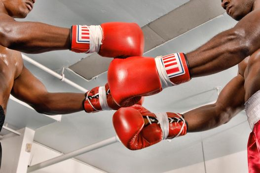 Close up shot of boxers on the ring