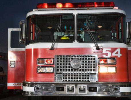 Close up shot of Fire engine and ambulance at night