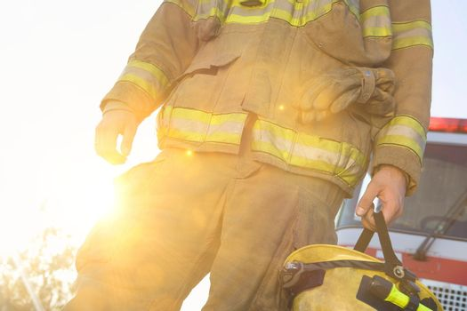 Photo of Fire fighter holding helmet