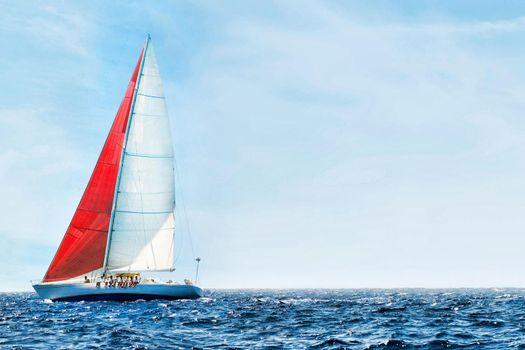 Sailboat in the peaceful blue ocean against sky