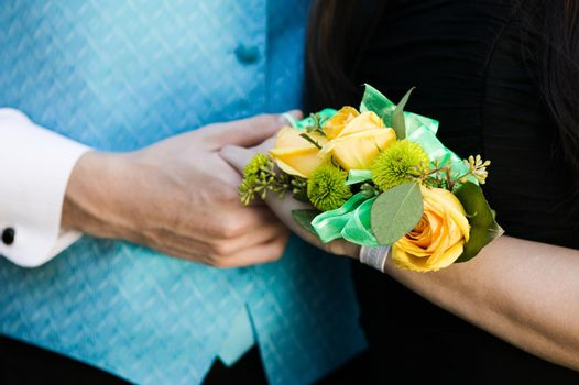 Teenage Girl wearing corsage with prom date