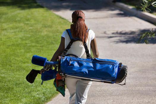 Woman Carrying Golf Club Bag