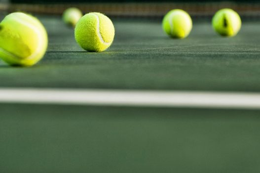 Row of Tennis Balls on Court Surface