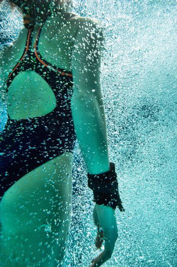 Portrait of Athletic Swimmer in pool