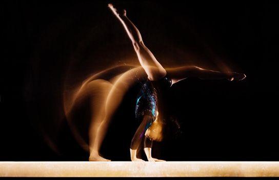 Gymnast Doing Split Handstand on Balance Beam