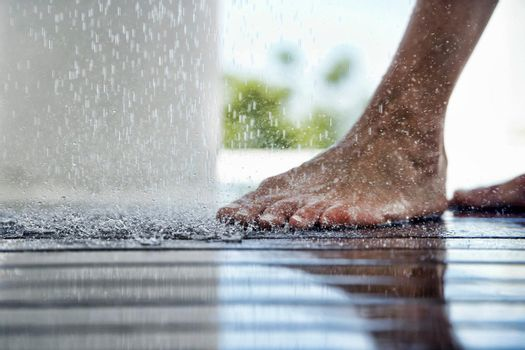 Closeup photo of Foot Under Dripping Water
