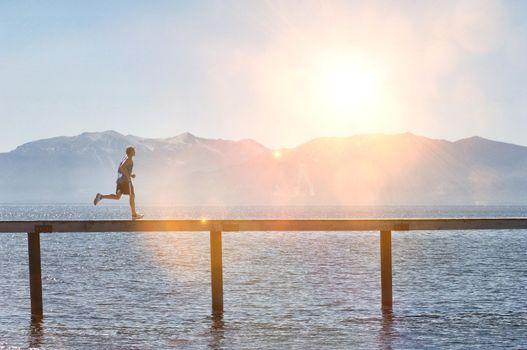 Photo of Man Jogging along Pier