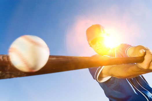 Batter Hitting Baseball on sunny day