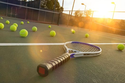 Photo of Tennis Racket and Balls on Court