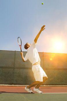 Photo of Man Serving Tennis Ball