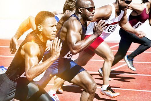 Portrait of athlete runners running on track