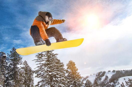 Portrait of Male Snowboarder with lens flare