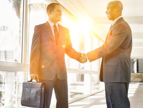 Portrait of businessmen shaking hands in the office