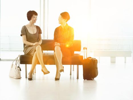 Businesswomen sitting on bench in the airport