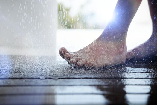 Close up photo of Foot Under Dripping Water