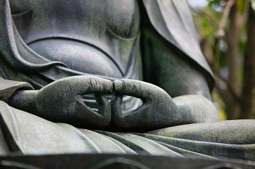 Buddah statue hands close up