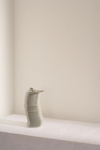 Stack of plates and cutlery on table