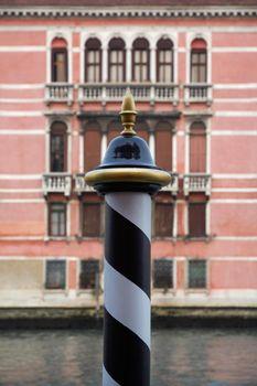 Italy Venice focus on pole by canal