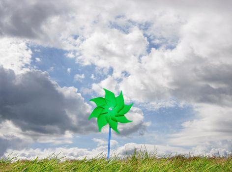 Pinwheel against cloudy sky