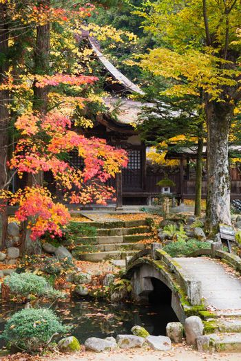 Japanese temple with bridge and trees