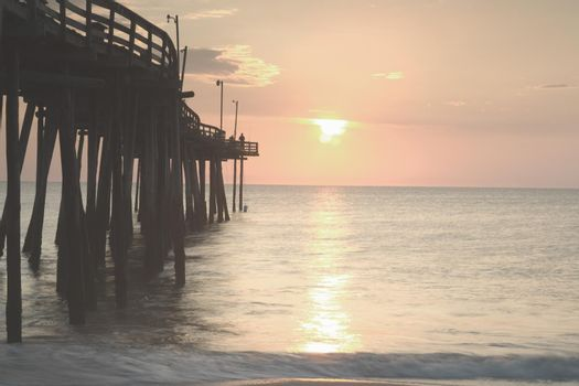 View of sunset over sea with pier