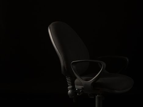 Office chair on black background