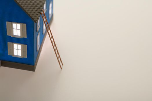 Model of house with ladder