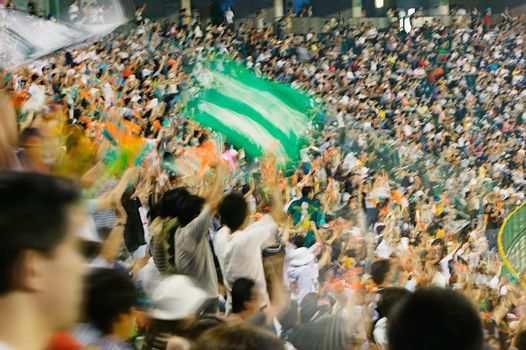 Blurred photo of Fans in football stadium