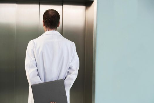 Physician Waiting for the Elevator