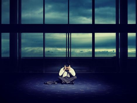 Frustrated Businessman in Dark Room