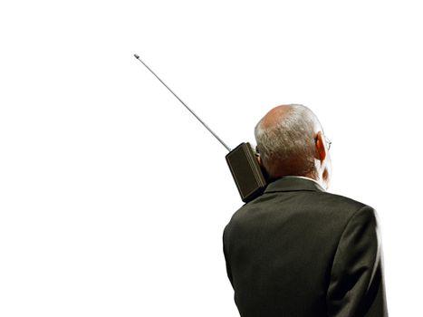 Senior business man using vintage radio