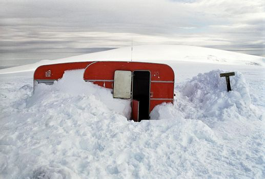Mobile home covered in snow