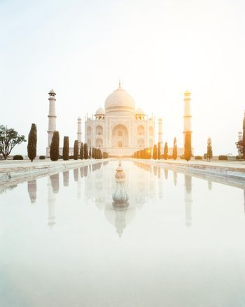 Taj Mahal with nobody in the photo with sunshine in background