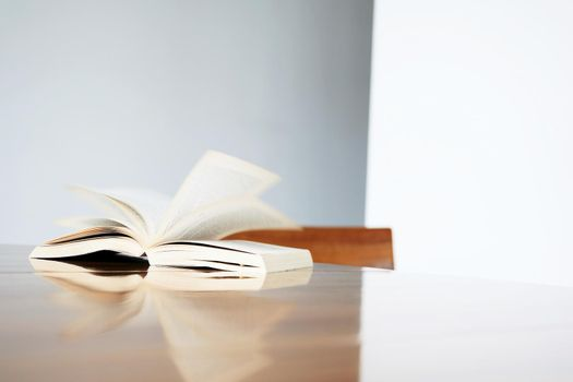 Book open at a page on table