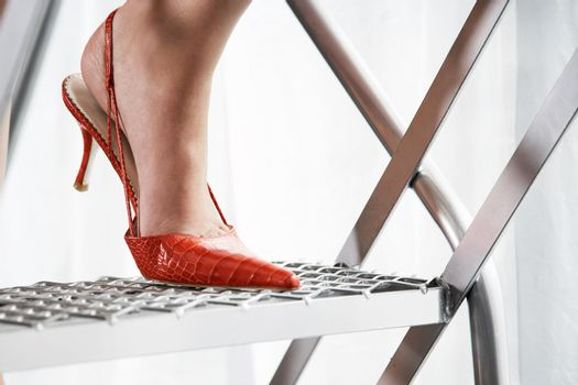 Close up of stilleto heel on metal staircase