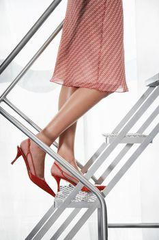 Woman wearing  stilleto heel on metal staircase