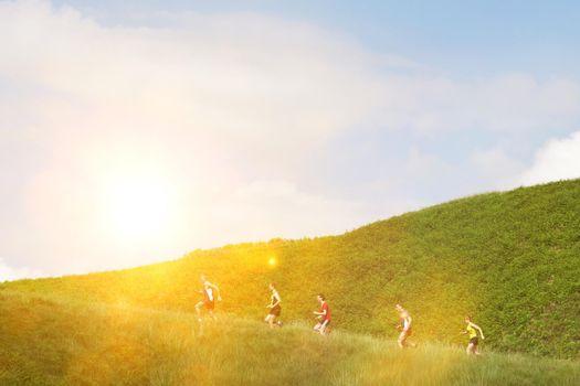 Group jogging up hillside