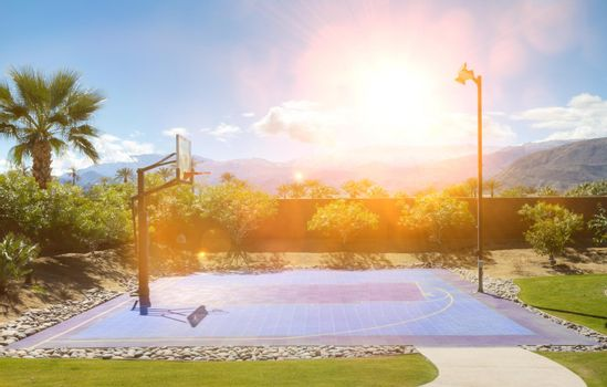 Basketball court in hot sunshine